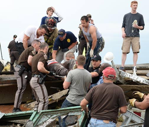An injured person is removed from the rubble in the aftermath of a huge tornado that struck Moore, Oklahoma, Monday, May 20, 2013.  At least 51 people were killed, including at least 20 children, and those numbers were expected to climb, officials said Tuesday. *MCT photo