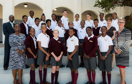 Students at Sandys Secondary Middle School students who have benefitted from a financial donation towards anti-bullying programme Chain Reaction Bermuda with representatives from Argus, Chain Reaction Bermuda and Sandys Secondary Middle School. *Photo supplied