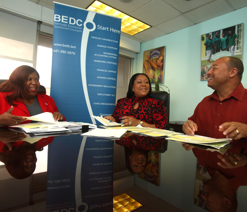 Brain trust: Erica Smith, left, executive director for Bermuda's Economic Empowerment Zones, meets with zone officers Roxanne Christopher and Ray Lambert. *Photo by Nicola Muirhead