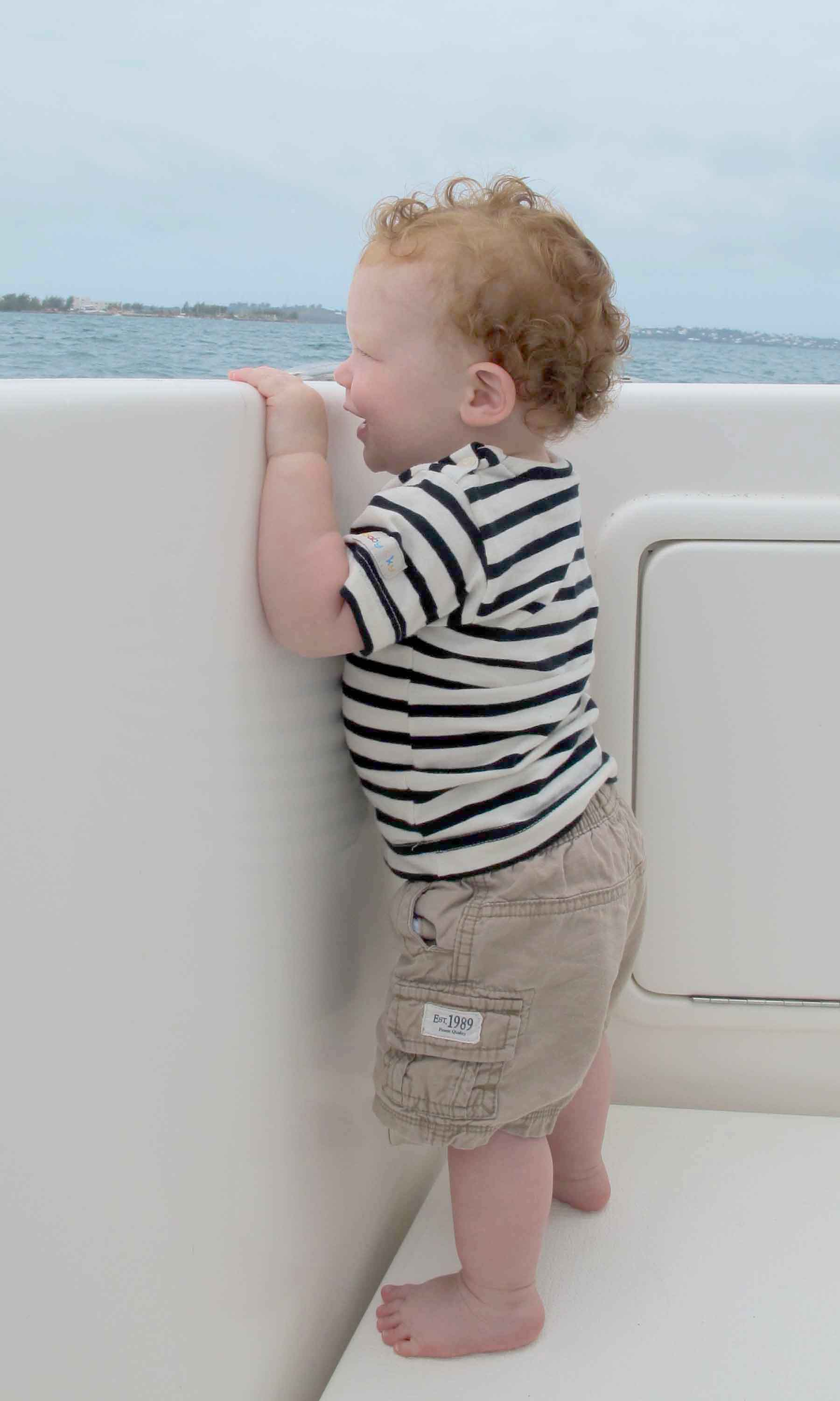 Captain Holden: Despite getting a little wet, Holden still enjoyed celebrating his first Mother's Day with a boat ride. *Photo by Robyn Bardgett