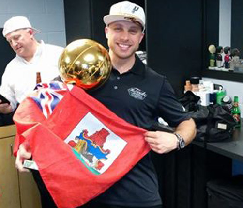 Matthew Herring is seen here showing off his Bermudian pride by draping the flag around the NBA Championship trophy after the San Antonio Spurs beat the Miami Heat last night. *Photo via Matthew Herring's Facebook page