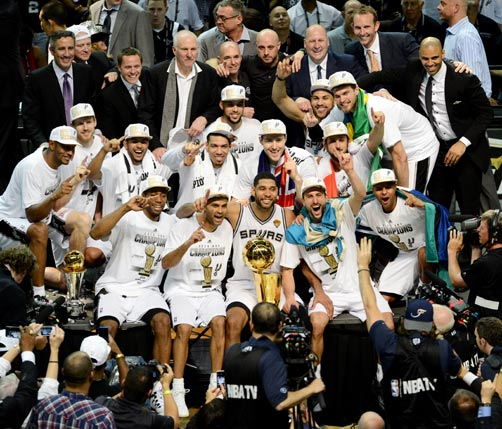 The San Antonio Spurs start the party after their NBA Finals win. Bermuda's Matt Herring is back row, fourth from the right. *AFP photo