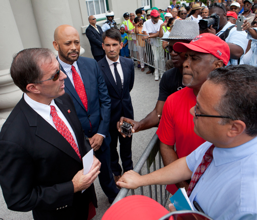 Premier Michael Dunkley speaks with Reverend Nicholas Tweed and BIU leader Chris Furbert at the culmination of today's march. *Photo by Glenn Tucker