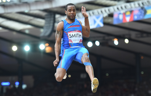 Tyrone Smith strains every last centimetre out of his qualifying jump. *AFP photo