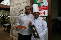 Welcome: Livio Ferigo and chef Javaha picture outside the recently opened Café Amici. *File photo