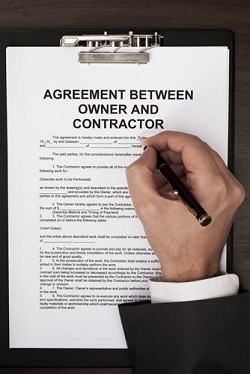 <strong>A must</strong>: For your protection you should draw up a detailed contract with your contractor. <em>*iStock photo</em>