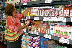 <strong>Seasoned shopper</strong>: Customer Alison Marshall shops for seasonings at the bulk retail store More for Less in St George's. <em>*Photo by B. Candace Ray</em>