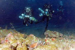 Technical divers Wayne Meaden, Mike Gascoigne and Graham Maddocks of the Ocean Support Foundation approach the Natural Arch cave that is guarded by lionfish - depth 200ft. *Photos by Ondrej Hindl/Ocean Support Foundation