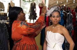 <strong>Finishing touches</strong>: Paulette Wedderburn, Revelation Boutique owner, left, does all she can to meet her clients' needs and make them feel 'special'. <em>*Photo by Kageaki Smith</em>