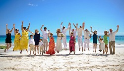 <strong>Setting</strong>: This wedding party jump for joy after the ceremony, at the beautiful location of Elbow Beach. <em>*File photo by Kageaki Smith</em>