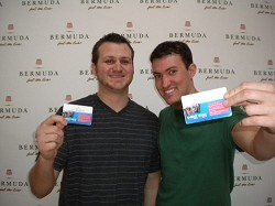Welcome: Kenny DeHaun, left, and Nicholas Comegna from California with their Event Passes. The students are among those enjoying their first visit to Bermuda as part of 'Spring Break'. <em>* Photo by Amanda Dale</em>