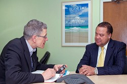 Minister Furbert discusses Bermuda with UK travel writer Simon Calder. *Photo supplied