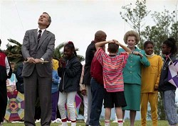 <strong>When the Iron Lady flew a kite in Bermuda</strong>: It was Good Friday, 1990, and amid tensions over the Soviet Union and the rest of Eastern Europe, President George Bush Snr and British Prime Minister Margaret Thatcher took time out from a summit in Bermuda to fly kites with youngsters. This is one of 26 historic photographs in a show at the Masterworks Museum of Bermuda Art. <em>*Photo courtesy of the US Consulate General</em>
