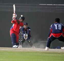 Kamau Leverock drives one to the ground. Leverock scored 15 runs.<em> *Photo courtesy of the ICC</em><br />