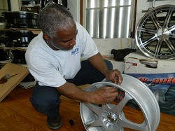 Clevie Simmons, who runs AutoStar, is seen attaching sensors to a tyre rim of a wheel arch. <em>*Photo by Simon Jones</em>