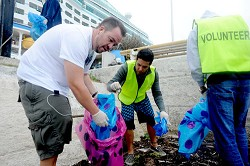 Helping hand: The crew of the Norwegian Dawn pitched in by helping clean-up Dockyard and the surrounding area as part of its Earth Day efforts. <em>*Photo supplied by the Norwegian Dawn</em>