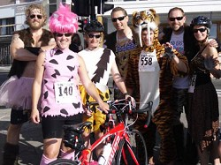 Dressed to impress: The First Atlantic Commerce tea, dressed here as cavemen, have raised over $50k for charity through the Catlin Bermuda End-to-End race. <em>*Photo supplied</em>