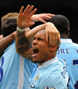 So close: All Manchester City have to do is win against QPR to wrest the league title from cross-town rivals United. <em>*AFP photo</em>