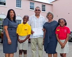 From left: Judith Alexander, principal of Purvis Primary School; Marquise Rawlins, Purvis Head Boy; David Burch; Education Minister Dame Jennifer Smith; and Zakira White, Purvis Head Girl. <em>*Photo supplied</em>
