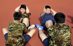 Overweight Chinese boys do sit-ups as they take part in a weight-lost camp in Shenyang, northeast China's Liaoning province. <em>*AFP photo</em>