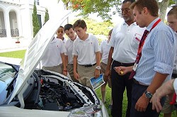Bermuda Motors' Fred Thompson (second right) explains to Saltus staff and students how Toyota's Hybrid Synergy System works. <em>*Photo courtesy of Bermuda Motors</em>