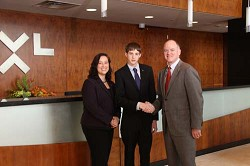 Opportunity: Vanessa Robinson, XL Scholarship Committee chair, with 2012 Scholar Ryan Whiting and Mike McGavick, CEO of the XL Group. *Photo supplied