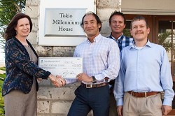 Tatsuhiko Hoshina, CEO of Tokio Millennium Re, presents Dr. Julie Dunstan, Executive Director of The Reading Clinic, with a cheque for $50,000. Also pictured (from left) are Tokio Millennium Re employees, Scribe Bror Muller and Johannes Puetz, Chairman of the Donations Committee. *Photo supplied