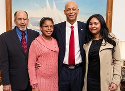 Fresh face: Newly-elected MP Sylvan Richards as he was sworn in as a Minister at Government House. From left, his father, also Sylvan, daughter Joi and wife Yahaira. *Photo by Kageaki Smith