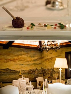 Exotic: Top, Istanbul's lamb chop kebab with thyme, paprika, mint yoghurt, lemon, goats cheese and pomegranate. Bottom, The PanAm Sky Club Mural at Tucker's Point restaurant The Point. <em>*Photos by Sarah Lagan</em>